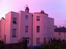White building turns to pink as the sun departs